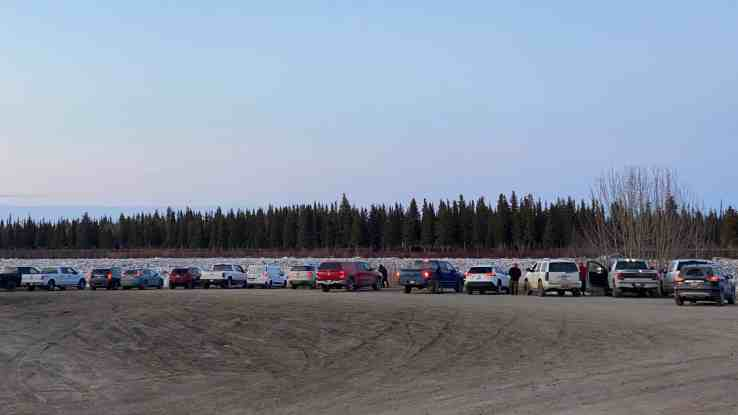Hay River residents gather at the ice crossing to view the river breakup on the evening of May 4, 2020