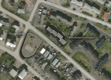 A playground, centre left, is seen opposite apartment buildings – one of which burned down on Saturday – in a satellite image of Inuvik's Kugmalit Road
