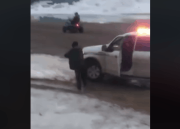 A still from a video shows a man approached by an RCMP truck in Kinngait on June 1, 2020