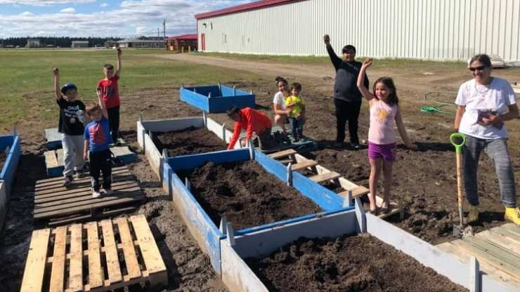 Youth in Fort Providence seeded outdoor garden beds in mid-June. Jason Collard/Northern Loco