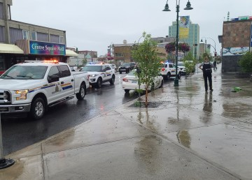Officers respond to an incident in downtown Yellowknife on July 1, 2020