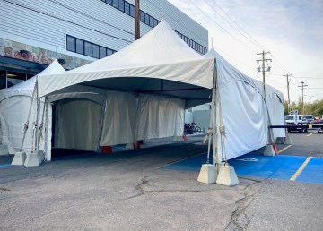 A tent marks the site of drive-through Covid-19 testing in Yellowknife