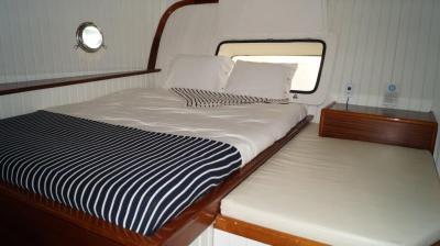 bedroom on 90ft Galeon Luxury Yacht Rentals in La Paz