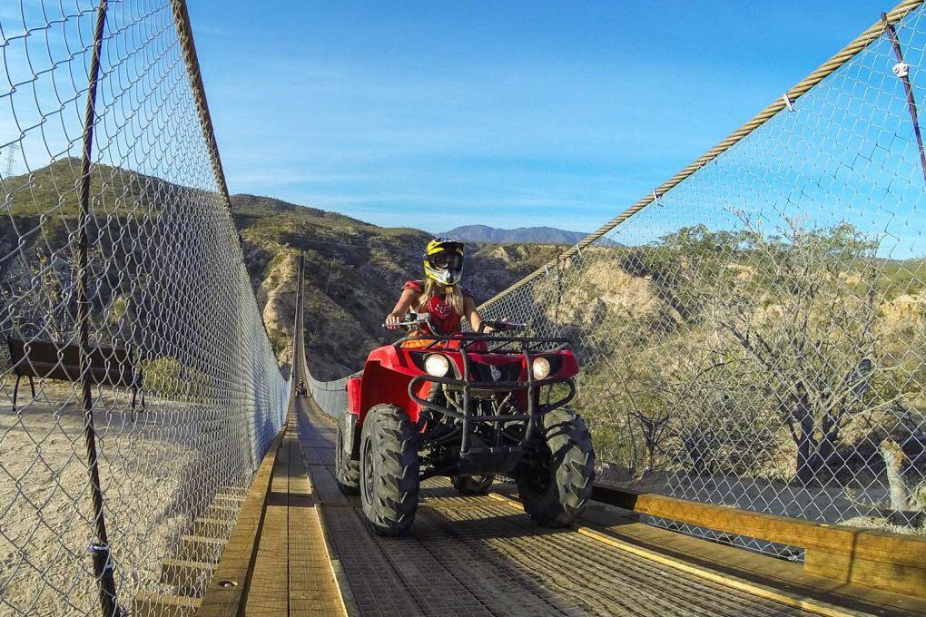 wild canyon atv tour crossing pedestrian suspension bridge