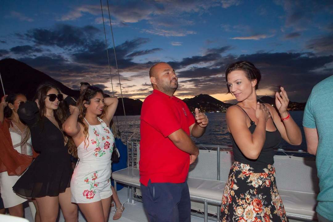 pez gato cabo sunset party cruise dancing staff