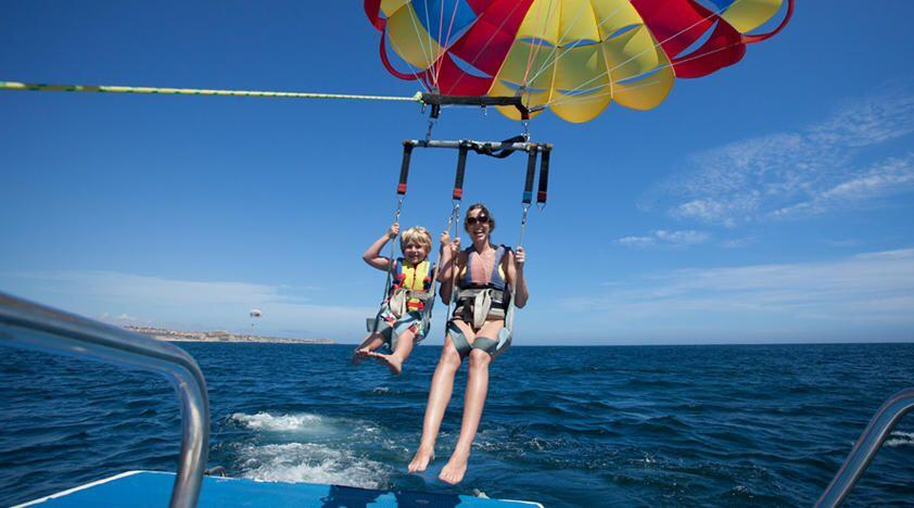 Enjoy some quality family time whilst parasailing in Cabo San Lucas cabo activities for kids in cabo