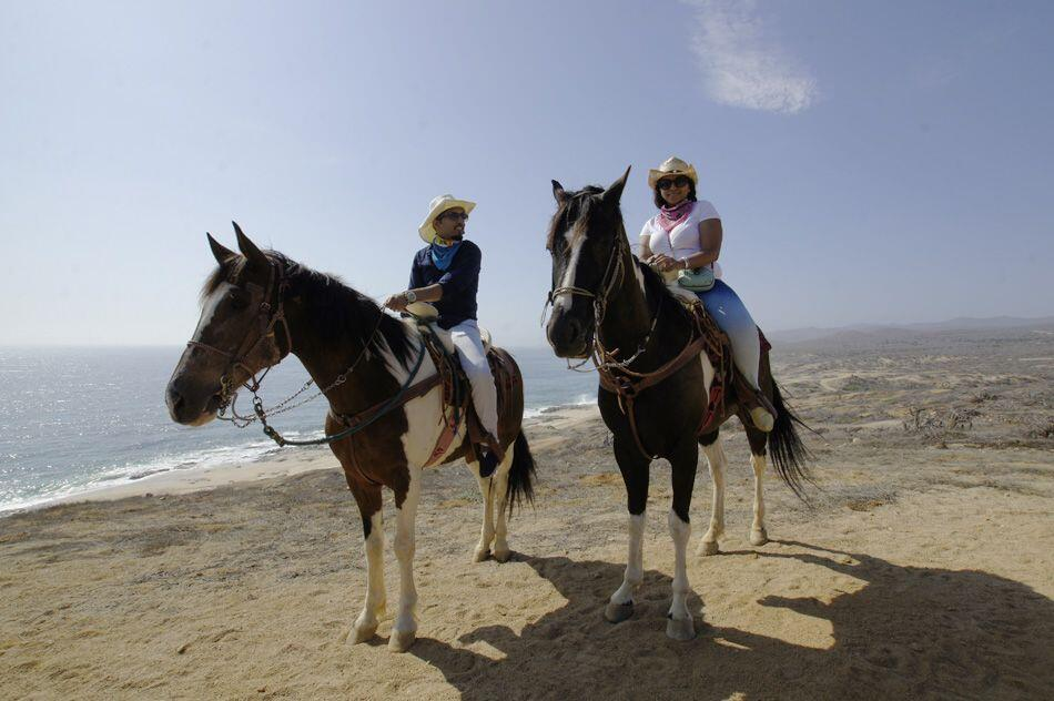 Horseback riding on the beach in Cabo San Lucas, Los Cabos near sunset best cabo activities
