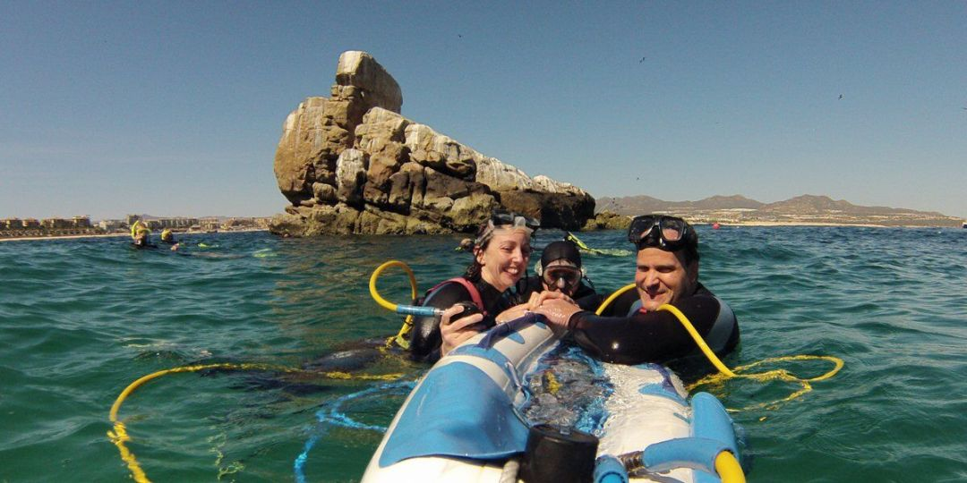 cabo snuba family snorkeling in medano beach near pelicans rock at lands end cabo arch