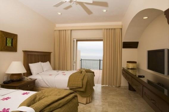 queen bed room Pueblo Bonito Montecristo Estates offers spectacular ocean views of the pacific ocean in cabo san lucas, overlooking quivira golf club