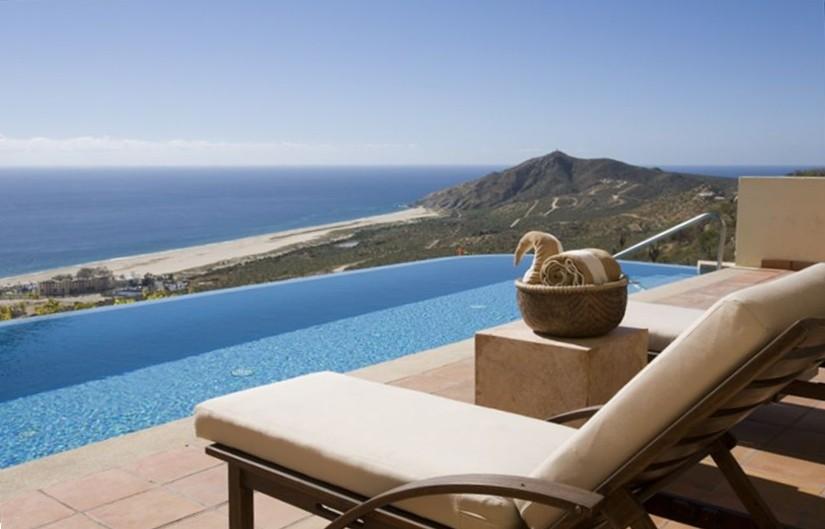 Infinity pool at Pueblo Bonito Montecristo Estates offers spectacular ocean views of the pacific ocean in cabo san lucas, overlooking quivira golf club