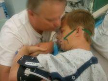 Zach-Miracle-26-Zach-off-breathing-machine-hugging-Dad