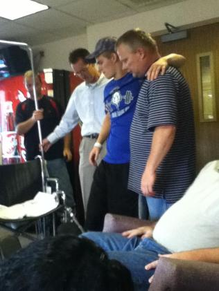 Zach-Miracle-44-Zach-walking-with-friends-in-waiting-room