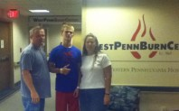 Zach-Miracle-57b-Zach-with-Dad-and-Mom-leaving-West-Penn-Burn-Center-2012-07-18