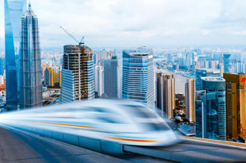 The world's fastest train in Shanghai (maglev train) shooting past in front of the high-rises in the city of Shanghai, China