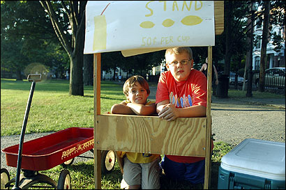 Dominic Serino (left), 9, and Ryan Decker, 11, were forced to pack up their lemonade stand at Salem Common on Saturday.