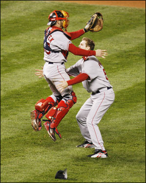 Red Sox catcher Jason Varitek (left) and Jonathan Papelbon celebrated on the mound after the victory.