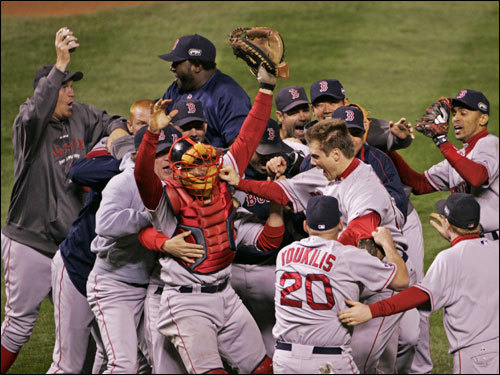 Red Sox players celebrated on the field after the win.