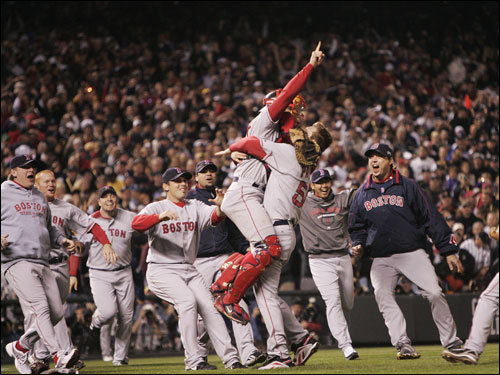 Red Sox players swarmed the field after pitcher Papelbon's final strikeout.