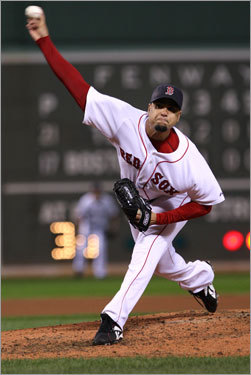 Red Sox reliever Manny Delcarment delivered a pitch in the fifth inning.