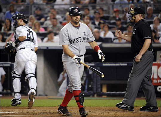 Home plate umpire Bill Miller calls Jason Varitek out after swinging and missing on a third strike pitch by Andy Pettitte. Pettitte went seven innings, giving up just five hits.