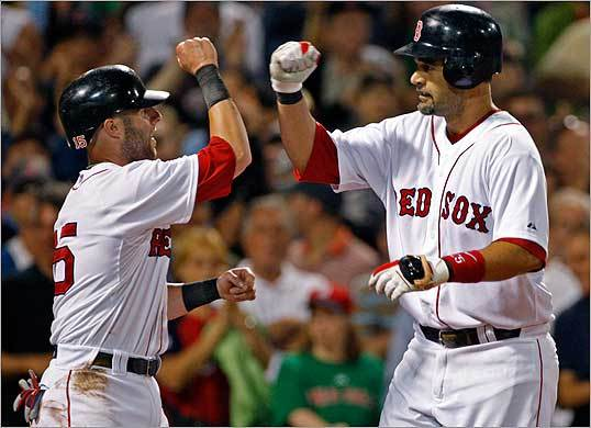 Lowell celebrated with Pedroia after hitting a home run.