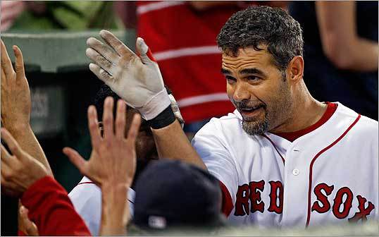 Mike Lowell was congratulated by teammates after he hit a solo home run in the second inning.