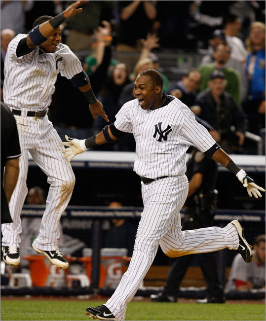 Marcus Thames (right) hit a walkoff home run in the ninth inning to lift the Yankees to an 11-9 victory over the Red Sox Monday at Yankee Stadium. The Red Sox trailed much of the game, but rallied to take a 9-7 lead in the eighth. Then the Yankees tied the score in the ninth on Alex Rodriguez's two-run home run, setting up Thames' heroics.