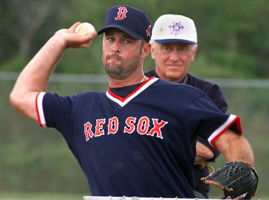 In Feb. 2000, Wakefield gets some instruction from knuckleball expert Phil Niekro at spring training in Fort Myers, Fla.