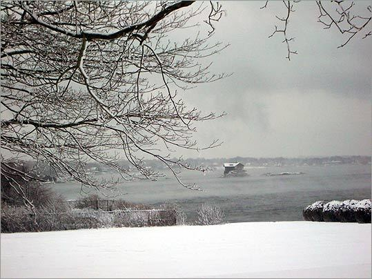 In wintertime, the House on a Rock stands out in the icy gray seascape.