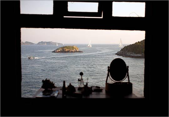 From a bedroom window at Clingstone, sailboats and power boats glide by.