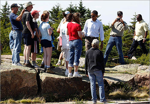 President Obama greeted people after walking along a trail on Cadillac Mountain.
