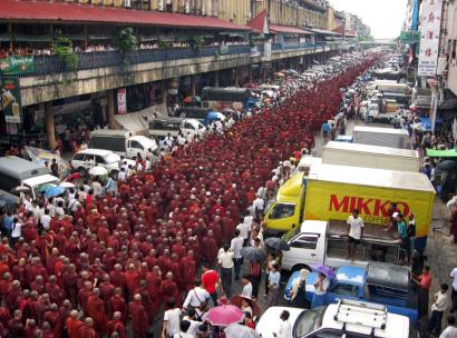 Tens of thousands of Burmese Buddhist monks and their supporters marched yesterday in antigovernment protests in Rangoon. Concerns are rising over possible violence.