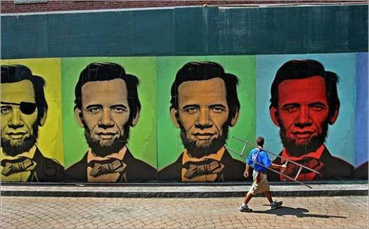 The mural by artist Ron English on Harrison Avenue features composite portraits of Barack Obama and Abraham Lincoln, their faces melded in a rainbow of colors.
