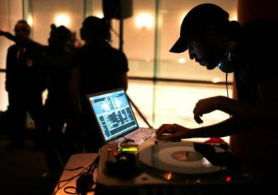 Many DJs are going high tech - yet acting like rock band  s. Pictured: DJ Ghostdad (Ryan Sciaino) at the Museum of Fine Arts in September.