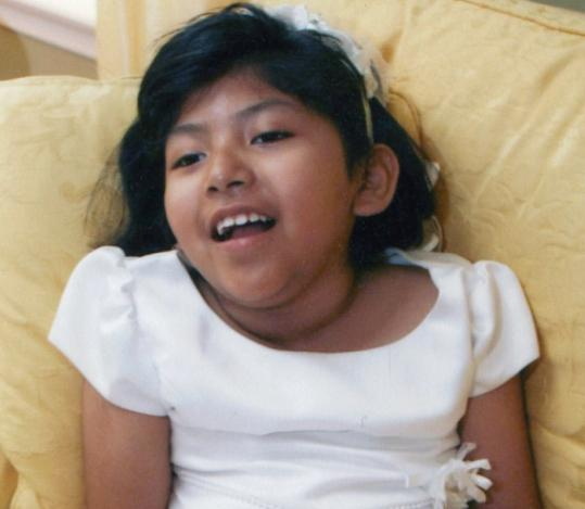 Marisol Liliana O'Brien, 8, seen in her First Communion dress, died Saturday in her home.