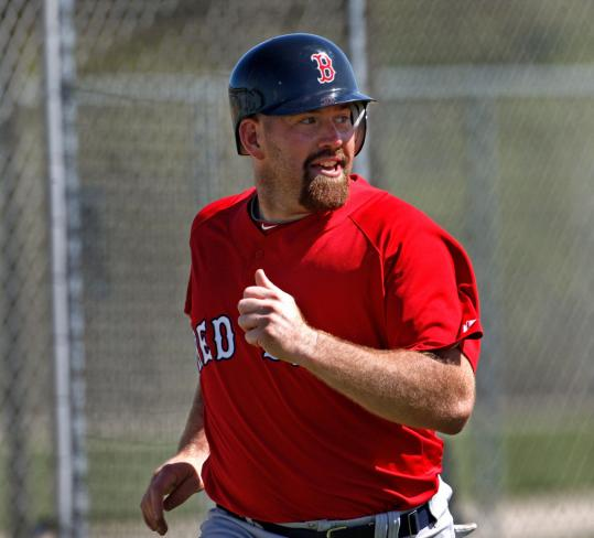 Kevin Youkilis is on the lookout during situational baserunning drills Monday.