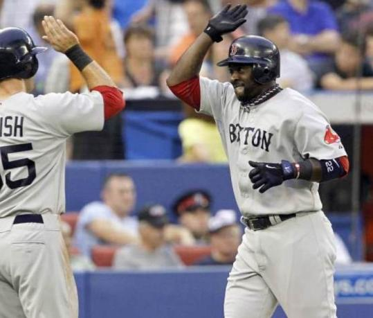 Bill Hall (right), who had two home runs, celebrates his second blast with teammate Ryan Kalish in the fourth inning.