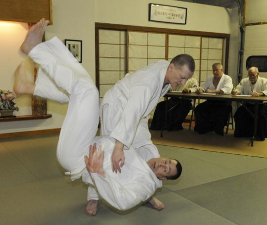 Serguei Vassiliev, who is blind, tests for his black belt in aikido, throwing opponent John Murphy to the ground.