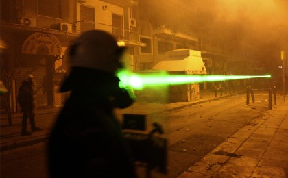 Protesters, unseen, aim a green laser pointer at riot policemen during clashes between protesters and riot police in Athens, Saturday, Dec. 13, 2008. (AP Photo/Petros Karadjias). Published in The Boston Globe, The Big Picture, 15 December 2008