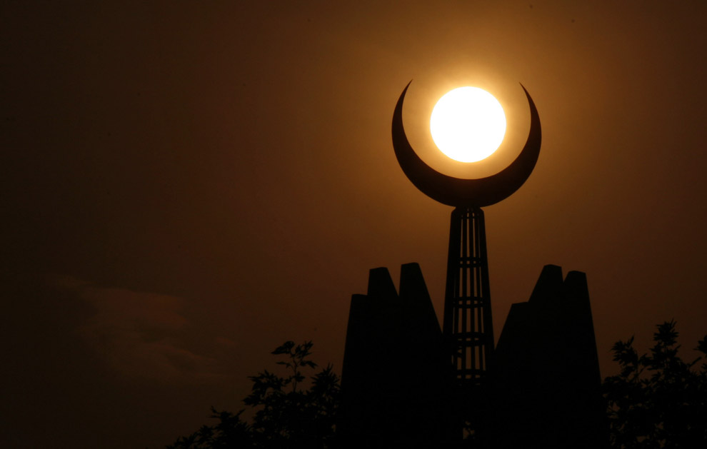 Symbolizing the faith of Islam, the crescent moon is seen at sunset on top of the Faisal Mosque in Islamabad, Pakistan