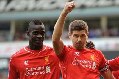Balotelli and Gerrard celebrate a goal at White Hart Lane