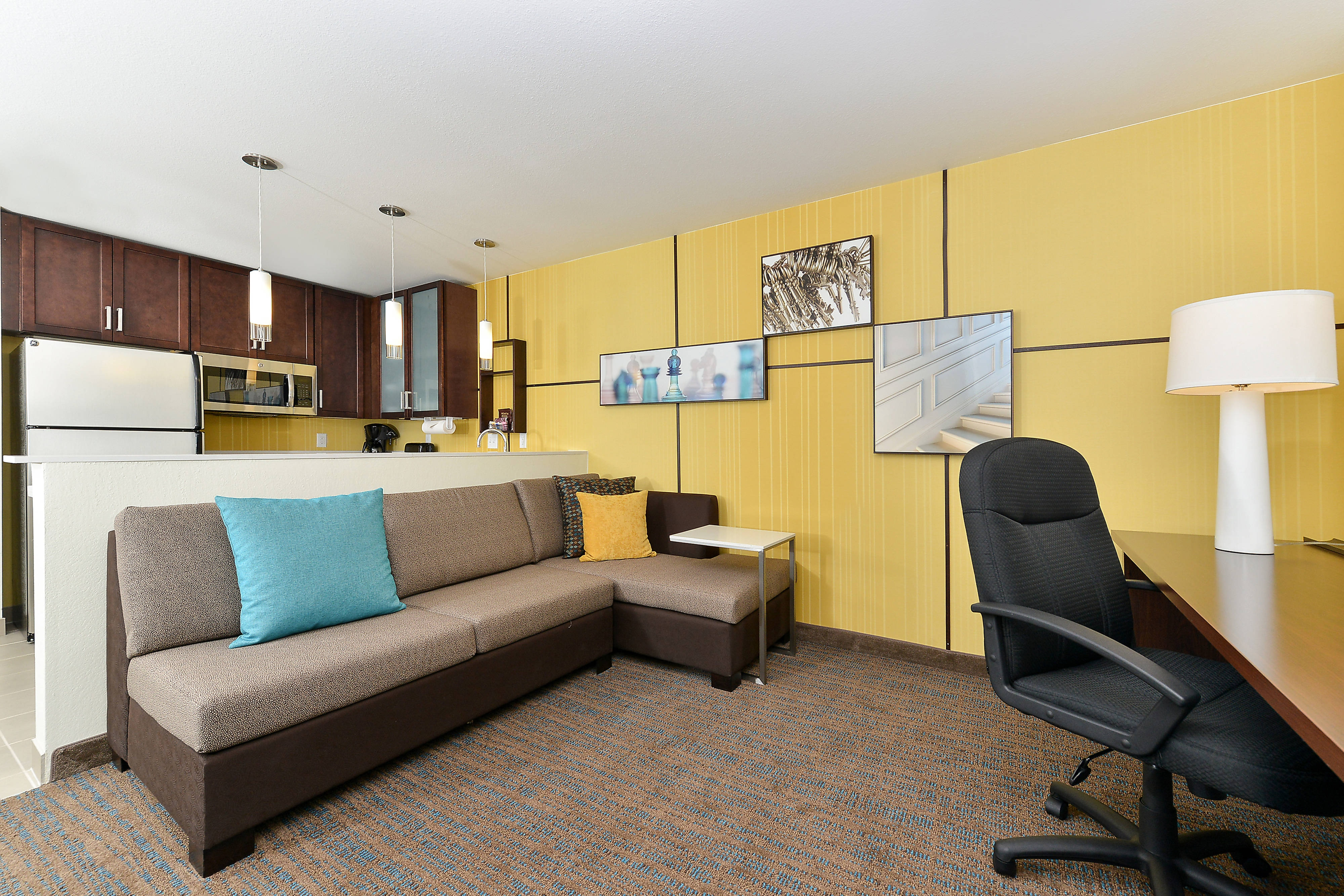 sofas by design des moines braxton leather sectional sofa residence inn downtown hotel amenities