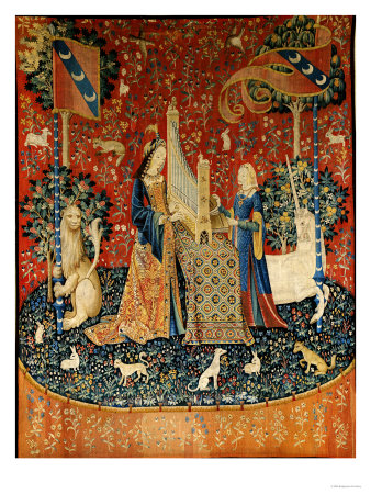 The lady, wearing an orange surcoat over a fitted dark blue dress, plays a portative organ on top of a table covered with a Oriental rug. Her maidservant, dressed in a sleeved surcoat of dark blue and rust, with gold inner sleeves, stands to the opposite side and operates the bellows. The lion and unicorn once again frame the scene holding up the pennants of the le Viste family. A unicorn is to the lady's left and a lion to her right. The tapestry is decorated with an overall mille fleurs design, and in the foregroud are rabbits and dogs.