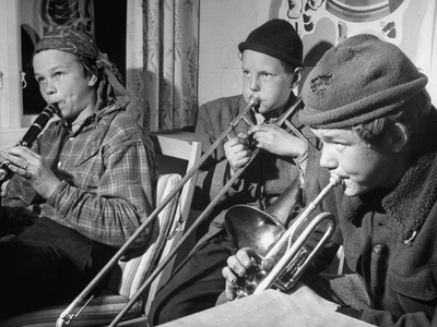 black and white photograph, three boys about ten years old, playing clarinet, trombone, and trumpet
