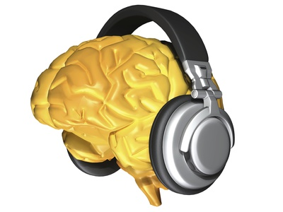 Yellow drawing of brain with silver and black headphones where the ears would be