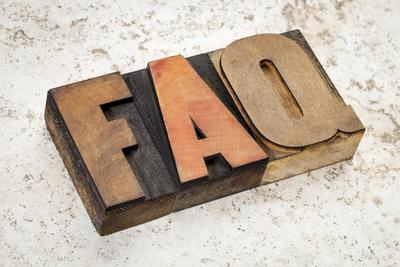 Woodblock letters spell FAQ