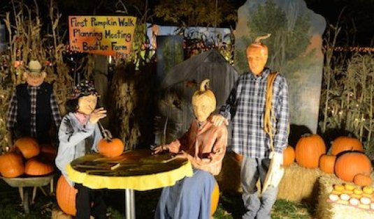 A scene from last year's 30th-anniversary Pumpkin Walk depicting Ida and Wallace Beutler and friends Nancy and Lyle Isrealsen planning the original Pumpkin Walk.
