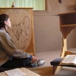 girl praying in chapel