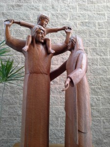 Statue of the Holy Family with Jesus on St. Joseph's shoulders