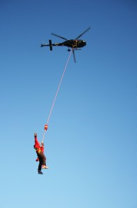 A rescue team prepares for a helicopter rescue.